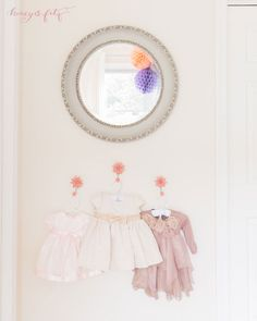 Project Nursery - Display Pretty or Sentimental Clothes in the Nursery as Decor