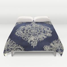 Buy ultra soft microfiber Duvet Covers featuring Cream Floral Moroccan Pattern on Deep Indigo Ink by micklyn. Hand sewn and meticulously crafted, these lightweight Duvet Cover vividly feature your favorite designs with a soft white reverse side.