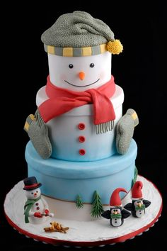My other entry in the OSSAS.  It made 1st in the adult advanced Holiday category.  Covered in fondant with fondant/gumpaste characters.  The hat and gloves are fondant.  I took little pieces of fondant to make it look like wool.  It took hours to do but I loved the effect.
