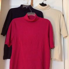 Set of three identical sweaters Deep purple, ivory, and red. Hard to find short sleeved turtlenecks.  Great quality from Coldwater Creek. $15 each Coldwater Creek Sweaters Cowl & Turtlenecks