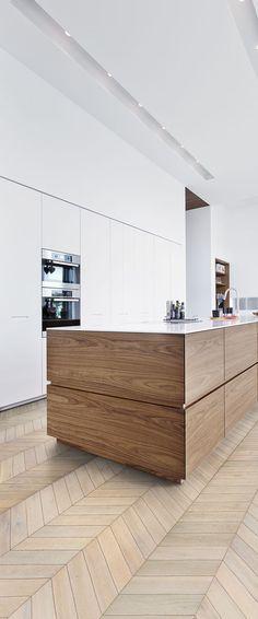 Modern and stylish kitchen design with wooden parquet flooring.
