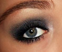 Grey + White Shimmery Eyeshadow with Black Eyeliner. My eyes are very similar to this color..
