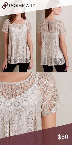 """Anthropologie Lace Metallic Top Embroidered Lyra Top by Akemi + Kin. Embroidered nylon lace Metallic detail Pullover styling Hand wash. Cami not included. 19"""" underarm to underarm and 26"""" L Anthropologie Tops Blouses"""
