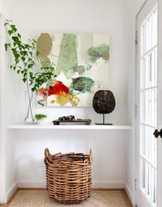 New entry way. Floating shelf from Lowes, same as we did our bedside shelves, chicken wire to close off the odd arch in the wall near the floor down to the basement. Grab some branches from outside and voila! (photo from apartmenttherapy)