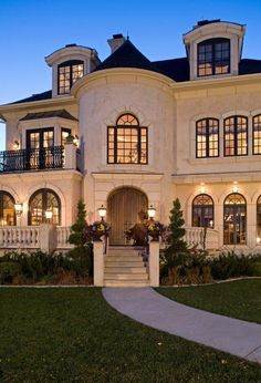 amazing home with turret. cream colored exterior with dark roofing. perfect evening lighting. #kcco