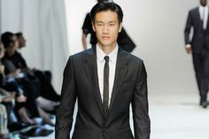 Dolce and Gabbana suit. Note the very skinny tie.
