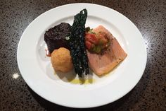 The entrée course will include a duo of filet mignon and slow-baked arctic char topped with a health-minded kale...