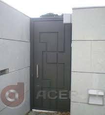 resultado de imagen para puertas modernas entrada hierro madera y crital
