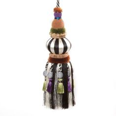 Pull it all together with color combinations from the MacKenzie-Childs palette. The thread-covered wooden Black & White Bibelot Tassel features poly/rayon silks and bead embellishments.