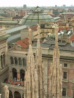 Sight from top of the Duomo in Milan (Italy), with the dome of the Vittorio Emanuele Gallery in the background