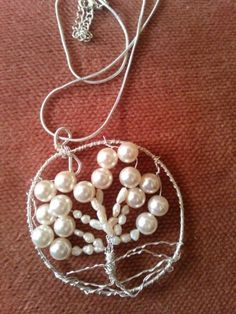 Tree of Life Jewelery by Anne Newton created with Pearls and silver plate wire.