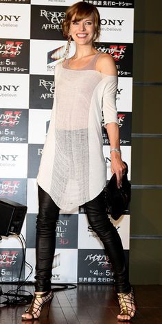 Jovovich rocked the Resident Evil: After Lifelife Tokyo press conference in leather leggings and a shredded tunic, accessorized with gold Jonathan Kelsey gladiators and a single, shoulder-dusting earring.
