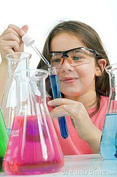 Girl in science class by Noam Armonn, via Dreamstime