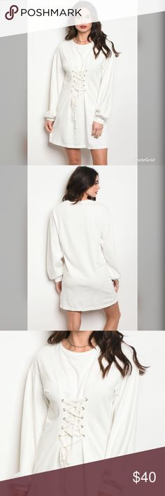 Off white dress Long sleeve sweater dress with a lace up cinched waist featuring a crew neckline. Dresses Long Sleeve