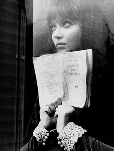 """Anna Karina reads Eluard in Jean-Luc Godard's Alphaville. 1965 """"There is another world, but it is in this one. Anna Karina, Cinema Video, People Reading, Francois Truffaut, French New Wave, Le Clown, Jean Luc Godard, Cult, French Films"""