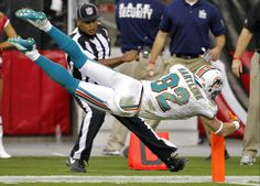 Miami Dolphins wide receiver Brian Hartline lunges for the end zone to score a touchdown. Week 4 2012 Season