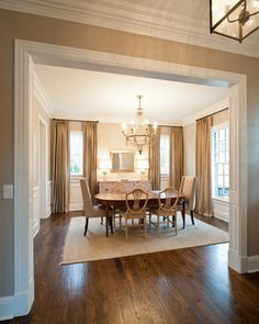 Base and crown moldings - at least 7 inches because of 9 foot ceiling height - love these casement openings for the foyer/living/dining areas if possible, and this wainscoting (applied - should be cost effective) for the dining room.