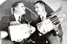 James Webb, NASA director, holds a model of the Apollo CSM. Dr. Joseph Shea, NASA Office of Manned Space Flight, holds a model of the lunar excursion vehicle. (July 11, 1962)