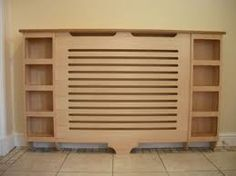 Radiators are a fact of life for those of us living in older houses and apartments. Interior Design Kitchen, Interior Design Living Room, Coat And Shoe Storage, Simple Living Room Decor, Beautiful Home Designs, Radiator Cover, Apartment Renovation, Lounge Decor, Radiators