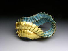 Bracelet | Jacqueline Ryan. 'Dragon'.  2011.  18ct gold with French Blue enamel