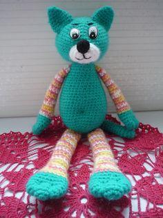 Вязание игрушки крючком по нашему мастер-классу поможет создать вязаного кота.. Фото №1