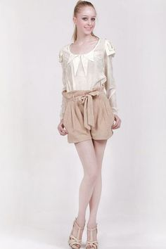 Shorts made of cotton blend fabric, featuring a high waistline with a belt, a concealed zipped closure to front.