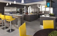 Yellow is also a cheerful tone that pairs really well with gray Yellow chairs--blue ceiling blue in dining room.