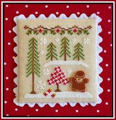 Gingerbread Girl and Peppermint Tree is the title of this second cross stitch pattern from the series by Country Cottage Needleworks titled 'Gingerbread Village'.