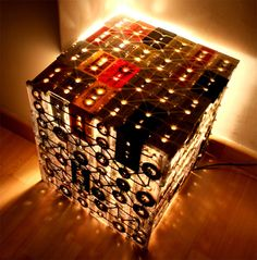 Ooomydesign'srecycled cassette lamp with its ambient 'analogue' glow. Jeremy would love this for his game room!