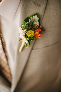 Billy Bob Boutonniere. I like the green leaf background. More yellow needed for our colors