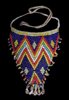 Africa | Cache-sexe apron from the Kirdi people of the Mandara Mountains of Northern Cameroon or Chad | Cotton, glass beads and cowrie shells | ca. early 1900s | 300$