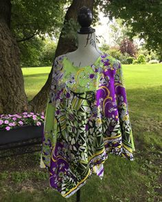 Polyester floral print Lucy wrap has a satiny sheen that compliments any figure type. Side slits on this poncho type top makes it great to wear under a jacket. One size fits all up to size 24 Green And Purple, One Size Fits All, Compliments, Floral Prints, How To Make, How To Wear, Wraps, Jacket, Type