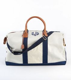 LARGE SAILCLOTH DUFFLE    This is the essential carry-all sail cloth duffle tote. Constructed in durable sail cloth material, tanned handles and sharp brass hardware. Detachable cotton webbing strap.