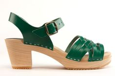 Herringbone Green Clog - Inspired herringbone cross-weave, open-toe sandal for fun in the sun, with a choice of orange or emerald green leather uppers. Staple construction and orthopedic alder wood, raised-arch foot bed on a 2 1/2-inch heel. Available in Ladies' sizes 35-42. Product Code 4002020. View here: http://capeclogs.com/our-clogs/picapica-high-heels/herringbone-green.