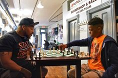 In the back of the Reflection Eternal Barbershop in Baltimore's Barclay neighborhood, owner Sundiata Osagie sits locked in an intense chess battle — with a 12-year-old boy.A skilled chess player, Osagie easily beats most of the customers who challenge him at his shop. But this is no ordinary …