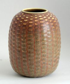Axel Salto for Royal Copenhagen. Stoneware budding vase with matte burnt orange matte glaze.