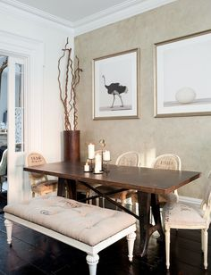 Elegant dining room with a greige accent wall adorned with The Animal Print Shop Ostrich Print and Ostrich Egg Print. A bronze colored floor vase holding twisted branches stands in the corner of the space. Not for me...but ooh lah lah!!