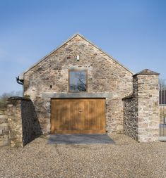 Donal Colfer Architects, Alice Clancy · Extension and Renovation of Ballymorris House. Concrete lintel over doors and concrete entry pad surrounded by gravel. Contemporary Architecture, Architecture Details, Barn House Design, Bungalow Renovation, Brown Doors, Ireland Homes, Stone Barns, Wexford Ireland, Courtyard House