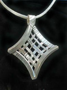 Pretty geometric pendant by Carol Scheftic.