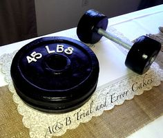 Barbell and Weight Plate Cake by A&B Trial and Error Cakes