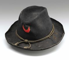 Union Officer's Slouch Hat.  Stiched to the front is the badge of the Eleventh Corps, First Division (red)  which fought at Chancellorsville and Gettysburg.  (Red-First Division of Corps.       White-Second Division of Corps.       Blue-Third Division of Corps.)