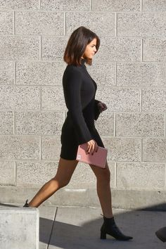 Selena Gomez and Justin Bieber attended church at Hillsong Conference in coordinating looks. Selena wore a black turtleneck dress while Justin complemented her in a black hoodie. See their looks, here. Selena Selena, Fotos Selena Gomez, Selena Gomez Photoshoot, Justin Bieber And Selena, Selena Gomez Style, Selena Gomez Bob, Selena Gomez Outfits Casual, Selena Gomez Tumblr, Selena Gomez Dress