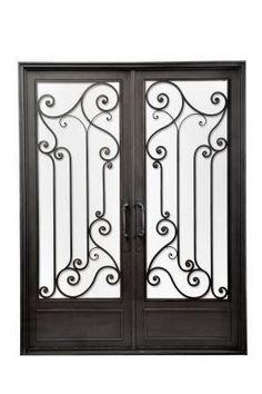 Mirá imágenes de diseños de Casas de estilo clásico en negro: Puerta de entrada de hierro forjado. Encontrá las mejores fotos para inspirarte y creá tu hogar perfecto.