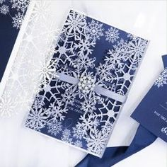 Silver glittery snowflakes is the pattern this Laser Cut wrap highlights! Complete with the wintery blue invitation, silver ribbon, and pearl and rhinestone embellishment, this is a winter wedding delight! Snowflake Invitations, Wedding Invitations, Snowflake Wedding, Reception Card, Response Cards, Pearl White, Floral Tie, Wedding Stuff, Snowflakes