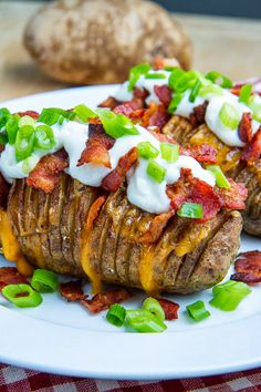 """Fully Loaded Hasselback Potatoes"" - with all of the flavors of a fully loaded baked potato including melted cheese, bacon, sour cream and green onions."