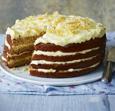 A whole orange is boiled and puréed to make a rich marmalade-y cake which is lightly spiced and decorated with curls of orange rind