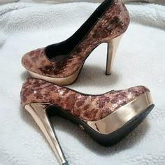 Mint..Dereon Platforms Make your statement with these cheetah glitter platform pumps! In mint condition and comes with a 5 inch heel. Platform measures 1 inch. Size 7.5...Sexy and dazzling!! Dereon Shoes Heels