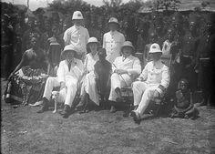 Belgian colonial administrators and Tetela chief [graphic] : Near Lusambo, Belgian Congo (now Democratic Republic of Congo). C. 1915