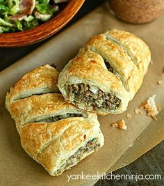 Easy recipe for flaky and hearty sausage rolls -- with plenty of handheld leftovers for on-the-go lunches -- from the Yankee Kitchen Ninja. Easy Appetizer Recipes, Snack Recipes, Cooking Recipes, Appetizers, Savoury Recipes, Dinner Recipes, Great Recipes, Favorite Recipes, Popular Recipes