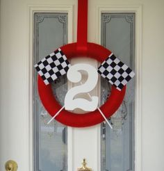 Disney Cars birthday wreath. See more birthday parties for kids at www.one-stop-party-ideas.com